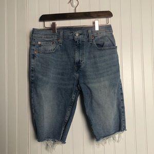 Levi's 502 cut off raw hem Jean shorts